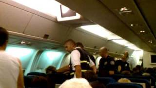 Guy getting arrested on flight from LAX to IAD