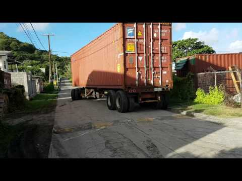 International backing up 40ft container in narrow spot