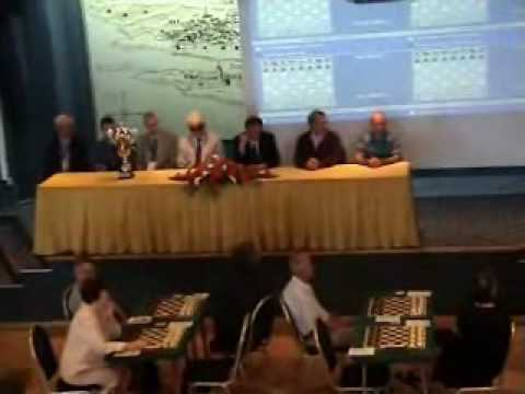The following is ORIGINAL TRANSCRIPTION -- Speaker and Moderator, FM Darko N. Dimitrijevic: Movie Part I -- 24th International Chess Tournament -- Pula 2010. Ladies and Gentlemen! In...