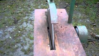 "Neat little circular saw bench with 15"" blade and 5.5hp engine"