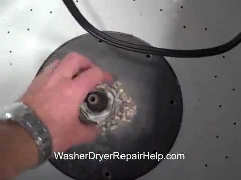 How to remove the agitator and basket on a GE washing machine