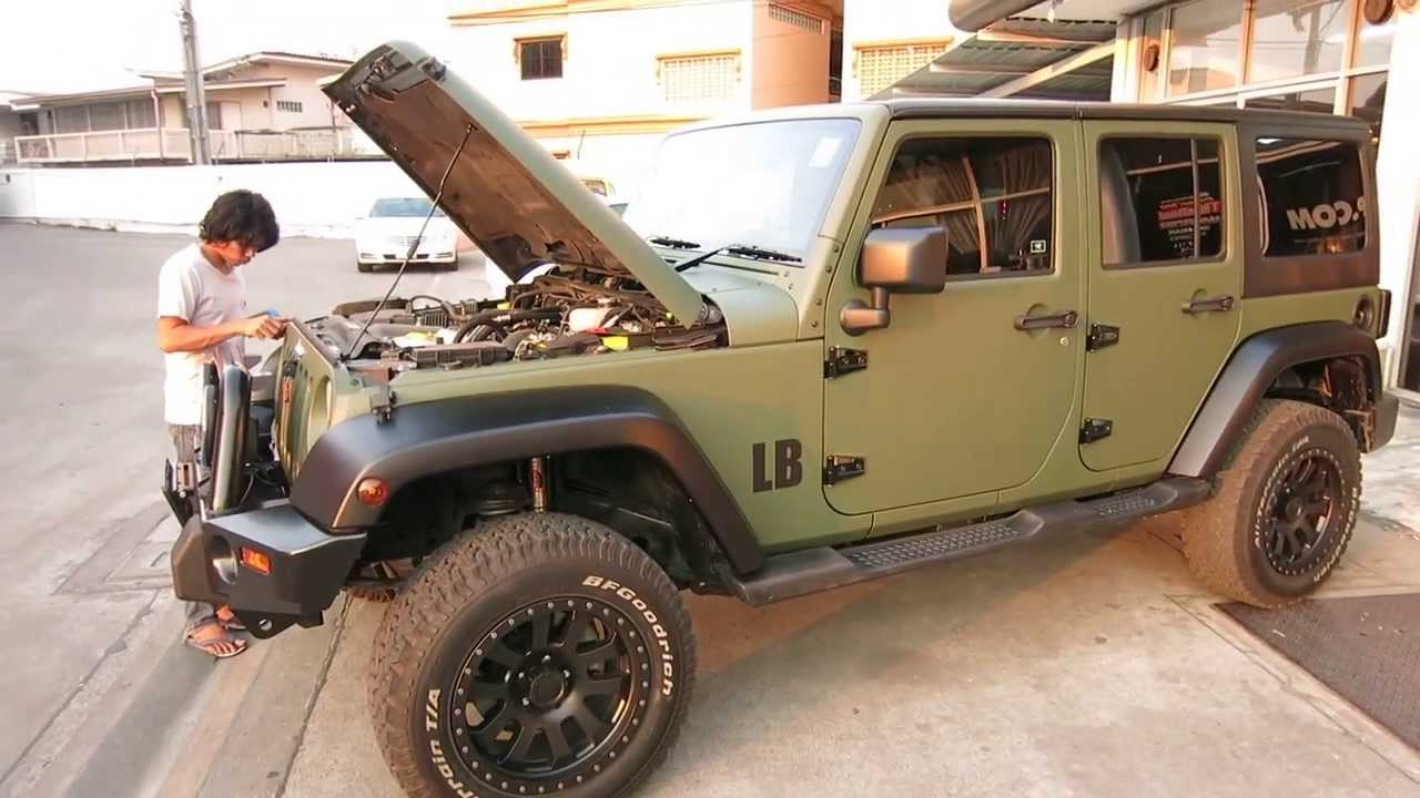 Matt Military Green Jeep Wrangler And Glossy White Bmw 5