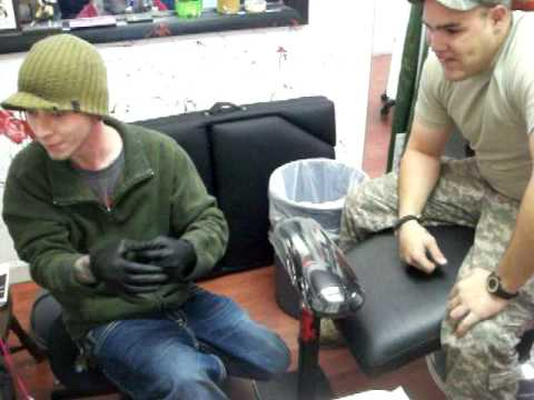 crazy man gets tattooed under his finger nail at Southside Tattoo in flint