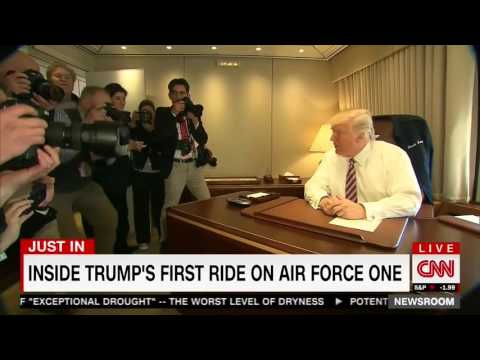 CNN Cuts To Trump On Air Force One As Commercials Blast On His TV