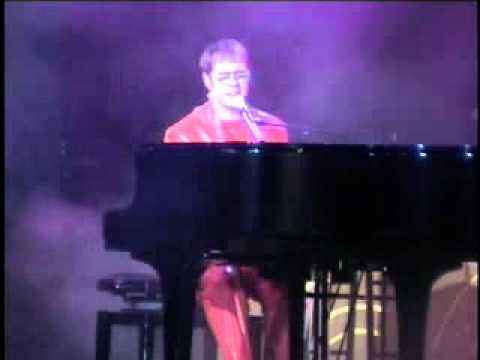 Joel Elton Joel Mason as Elton Benny And