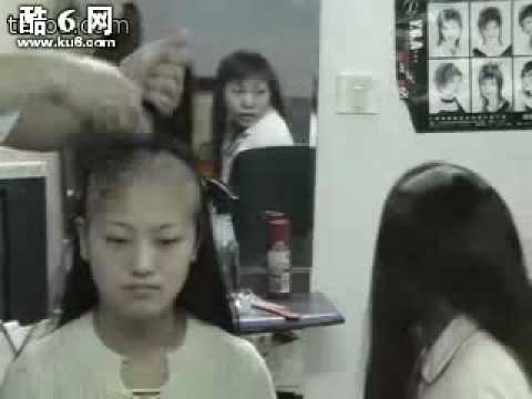 Two girls cut hair to bald together