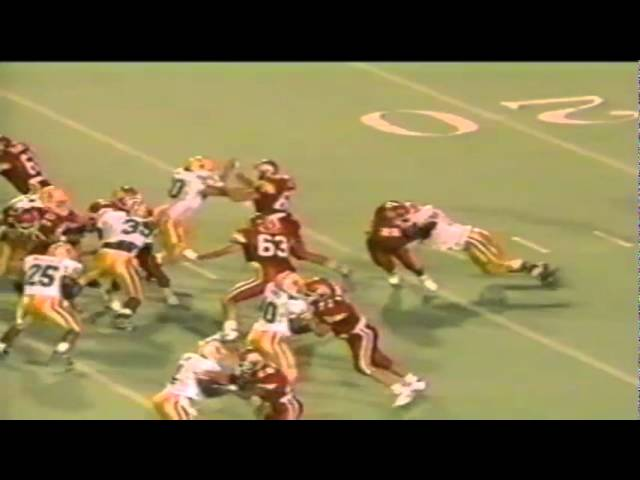 Oregon DT Marcus Woods gets in the backfield shutting down a run vs. Utah 9-21-1991