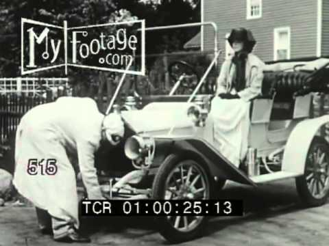 Stock Footage - VINTAGE. HAND CRANK. FRUSTRATED DRIVER (1910s) / CARS