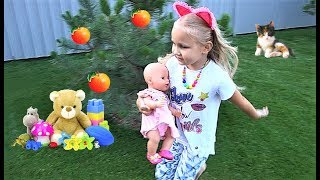 Alice play with fun puppet and show toys for a pretend baby doll