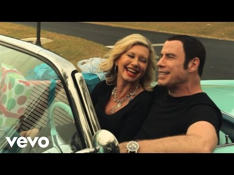John Travolta and Olivia Newton-John release creepy Christmas music video