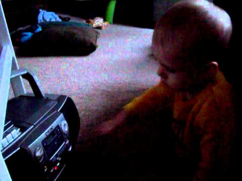 Baby Surfing the Radio