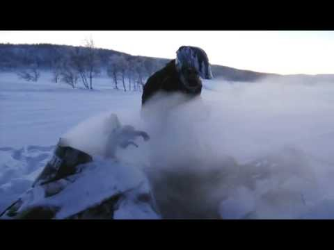 Arctic Cat ProClimb M1100 snowmobile on fire