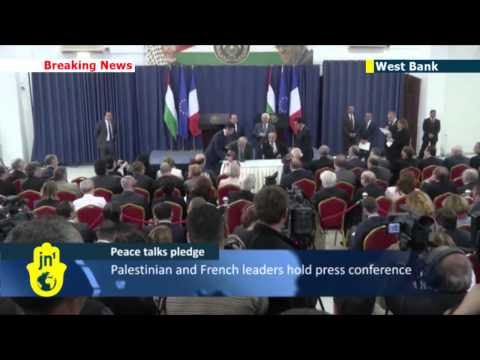 Hollande calls on Israel to freeze settlement building: Palestinians pledge to continue peace talks