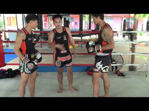Tiger Muay Thai Techniques: Block body kick followed by knee strike Image 1
