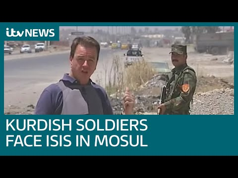 Kurdish soldiers face ISIS militants across