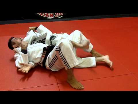 Jiu Jitsu Techniques - Escape from back mount / Lapel Choke defense Image 1