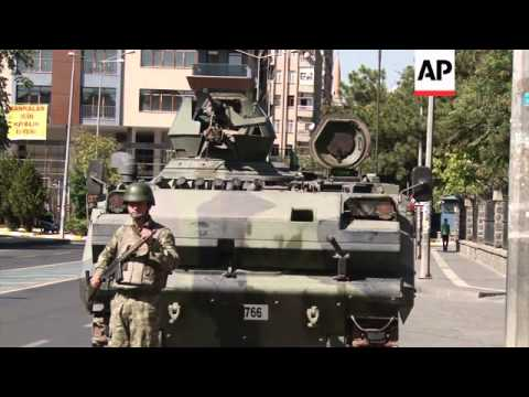 Damage, burnt out cars, military on streets after Tuesday's Pro-Kurd protests