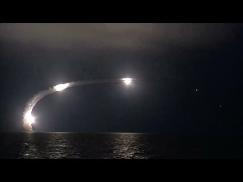 Russian ship launching a volley of missiles