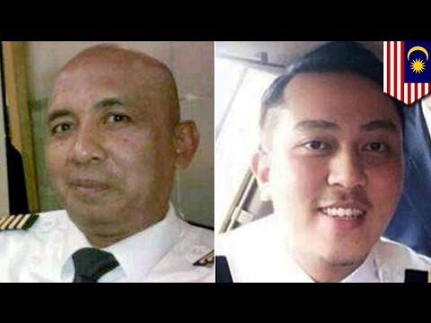 Missing Malaysia flight MH370: police search homes of pilots
