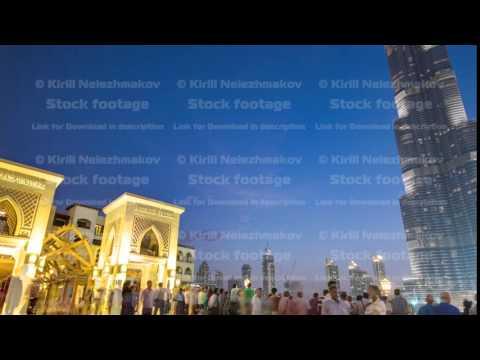 Bridge and fountains with Burj Khalifa day to night transition, Dubai, Emirates timelapse