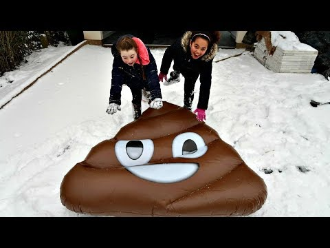 Kids Playing In The Snow On Giant Emoji Floaties | Toys AndMe