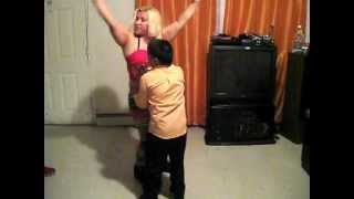 Dominican Republic mom dancing with her son in Newark, New Jersey