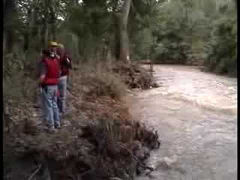 Footage of a search for a vehicle that was potentially washed away by creek flooding.