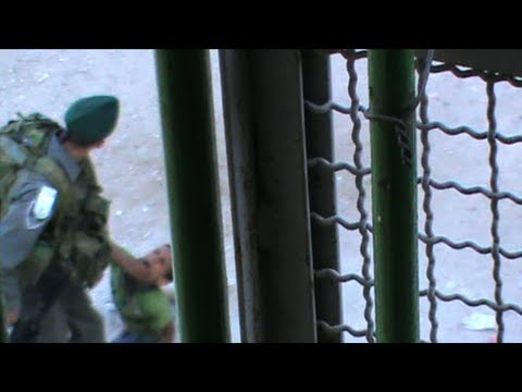 Hebron: border police officer kicks a palestinian child, 29/06/2012, raw footage