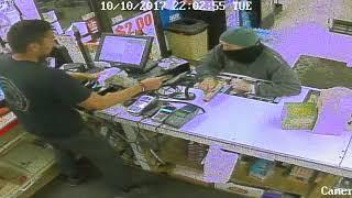 Armed robber fumbles cash at Kalamazoo party store
