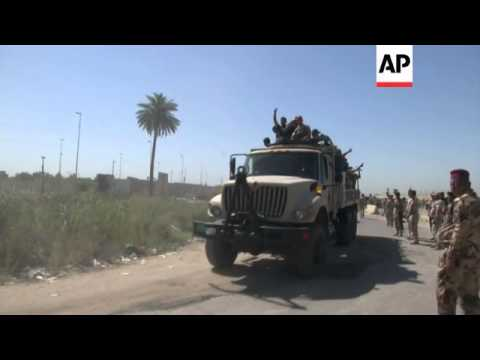 As Sunni insurgents pushed further into a province northeast of Iraq's capital, the central district