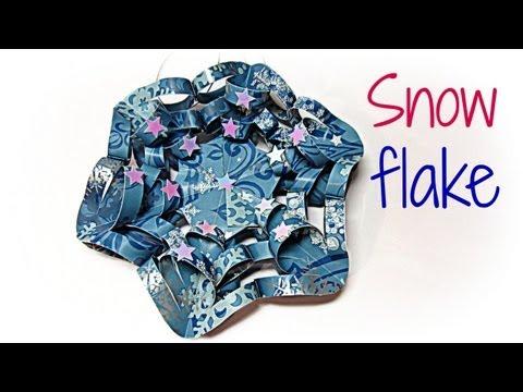 Adorno de Navidad (copo de nieve). Paper snow flake.