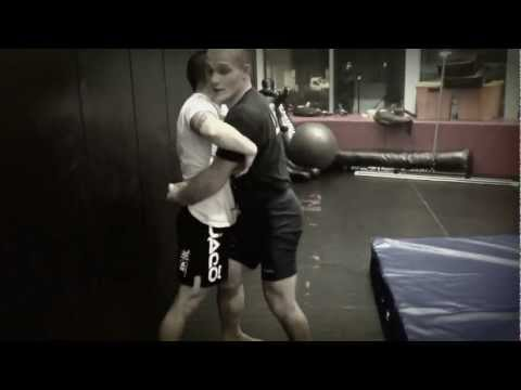 Greco Wrestling How to: Excellent Double Underhook Throw -off the cage for MMA Image 1