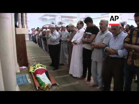 Mourners attend funeral of Palestinian man killed during Israeli raid on refugee camp