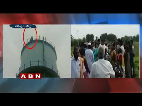 Woman Climb water tank to Protest against Revenue Officers | Khammam district