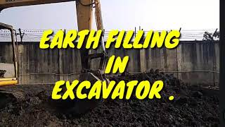 EARTH FILLING IN EXCAVATOR.