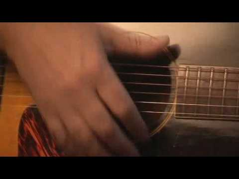 Ma rk Knopfler Showing his magic on an acoustic guitar