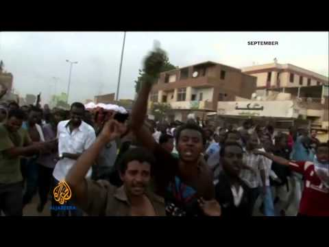 Sudan's Bashir unveils new cabinet