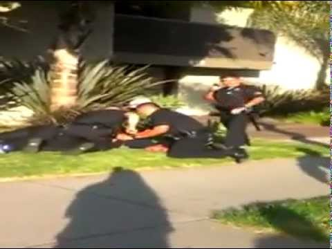 Los Angeles police beat a boy for skateboarding on the wrong side of the street
