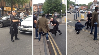 Armed Police Appear To Knock Furious Bystander