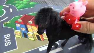 Peppa Pig rides a black horse. Peppa Pig saves a horse Tasha who twisted its leg. Peppa loves horses