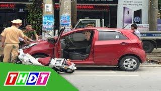 Mở cửa ô tô bất cẩn gây tai nạn, nữ sinh nguy kịch | THDT