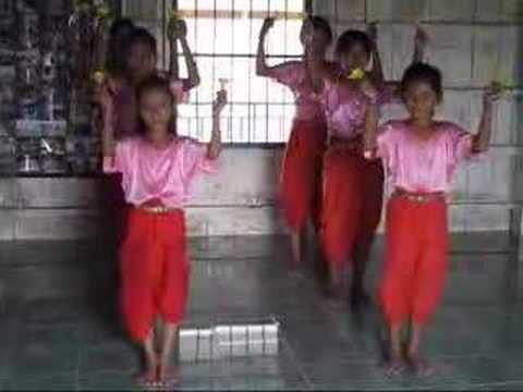 Girls dancing with lotus, Phnom Penh, Cambodia