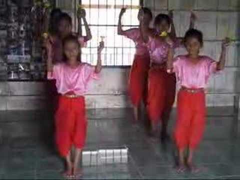 Girls dancing with lotus, Phnom Penh, Cambodia