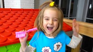 Girl and friends playing in colored paints, Learn Colors With Nursery Rhymes Song