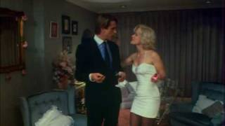 Jenny Seagrove in a tight mini-dress during a scene from the movie 'A Chorus of Disapproval'.