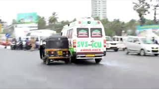Ambulance rams bike riders at traffic signal