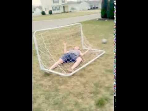 Hard hard hardcore fall ontop of a soccer net