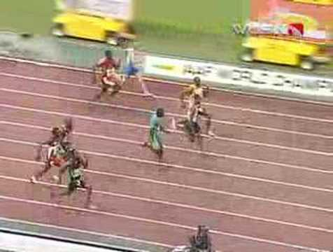 Gay chases down Powell for 100-meter gold