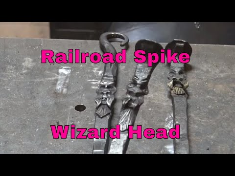 Forging a wizard head on a railroad spike - blacksmith
