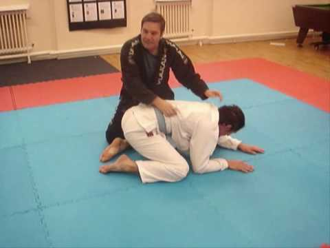 Gi Choke Submission against Turtle Guard Image 1